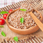 Buckwheat porridge in a wooden bowl — Stock Photo