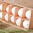 Eggs in a wooden container — Stock Photo