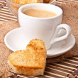 Heart-shaped toast  and a cup of coffee — Stock Photo