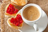 Heart-shaped toast with jam and a cup of coffee — Stock Photo