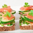 Appetizing sandwich with salmon - Stock Photo
