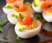 Stuffed eggs with salmon — Stock Photo