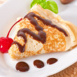 Stock Photo: Pancakes with chocolate and cherries