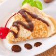 Pancakes with chocolate and cherries — Stock Photo #21301325