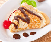 Pancakes with chocolate and cherries — Stock Photo