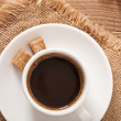 Closeup view of a cup of coffee and brown sugar - Stockfoto