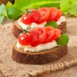 Stock Photo: Warm bread tomatoes, cream cheese and basil
