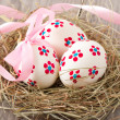 Easter eggs in nest on wooden table - Foto de Stock