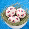 Easter eggs in a bowl decorated with a nest - Стоковая фотография