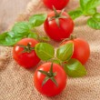 Freshly harvested summer cherry tomatoes on wooden background — Stock Photo #23171852