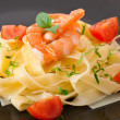 Pasta with shrimps and tomatoes — Stock Photo