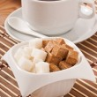Stock Photo: Cubes of white and brown sugar and cup of tea