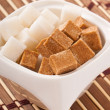 Close-up of cubes of brown and white sugar — Stock Photo