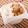 Stock Photo: Close-up of cubes of brown and white sugar