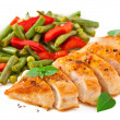 Stock Photo: Chicken breast with vegetables and sauce decorated with basil leaves