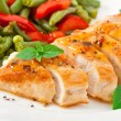 Chicken breast with vegetables and sauce decorated with basil leaves — Stockfoto