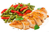 Chicken breast with vegetables and sauce decorated with basil leaves — Stock Photo
