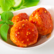 Meatballs in tomato sauce, decorated with leaves of basil — Stock Photo