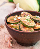 Fried zucchini in an old ceramic bowl — Stock Photo