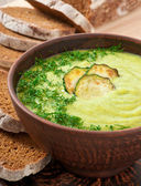 Zucchini cream soup in a ceramic bowl — Stock Photo