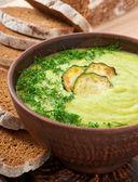 Zucchini cream soup in a ceramic bowl — Stock Photo