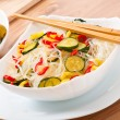 Stock Photo: Rice noodles and vegetables on white plate