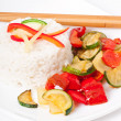 Stock Photo: Plate of vegetable fried rice and chopstick.