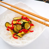 Rice noodles and vegetables on white plate — Foto de Stock