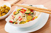Rice noodles and vegetables on white plate — Stock Photo