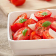 Tomato cherry salad with basil, black pepper and onion — Stock Photo