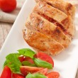 Stock Photo: Grilled chicken breast stuffed with basil, tomato and garlic