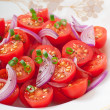 Tomato cherry salad with black pepper and onion — Stock Photo