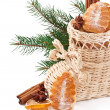 Wicker Christmas stocking filled with cookies, cinnamon sticks, candied lemon and star anise — Foto de Stock