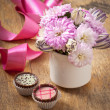 Stock Photo: Beautiful aster flower bouquet and chocolates on wooden table