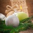 Christmas card with Christmas balls and a burning candle — Stock Photo