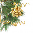 Green pine branch with gold bow on a white background — Stock Photo