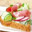 Sandwich with ham, cucumber and radish — Stock Photo