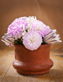 Beautiful aster flower bouquet on wooden table — Stock Photo