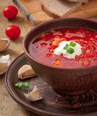 Ukrainian and russian national red soup borsch closeup — Stock Photo