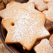 Homemade Christmas cookies sprinkled with powdered sugar — Stock Photo
