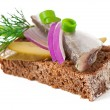 Stock Photo: Sandwiches of rye bread with herring, onions and herbs.