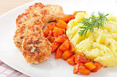 Fried cutlets, stewed pumpkin and mashed potatoes — Stock Photo