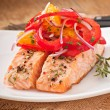 Stock Photo: Baked salmon with salad of sweet peppers and oranges