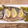 Baked fish dorado and roasted vegetables — Stock Photo