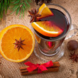 Christmas mulled wine in glass cup on a wooden table — Stock Photo #34266943