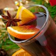 Christmas mulled wine in glass cup on a wooden table — Stock Photo #34266951