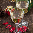 Two glasses of champagne on a dark old wooden background — Stock Photo #34898519
