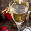 Two glasses of champagne on a dark old wooden background — Stock Photo