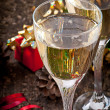 Two glasses of champagne on a dark old wooden background — Stock Photo #34898549