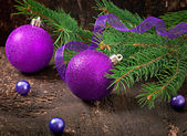 Christmas card with Christmas balls on old wooden table — Stock Photo